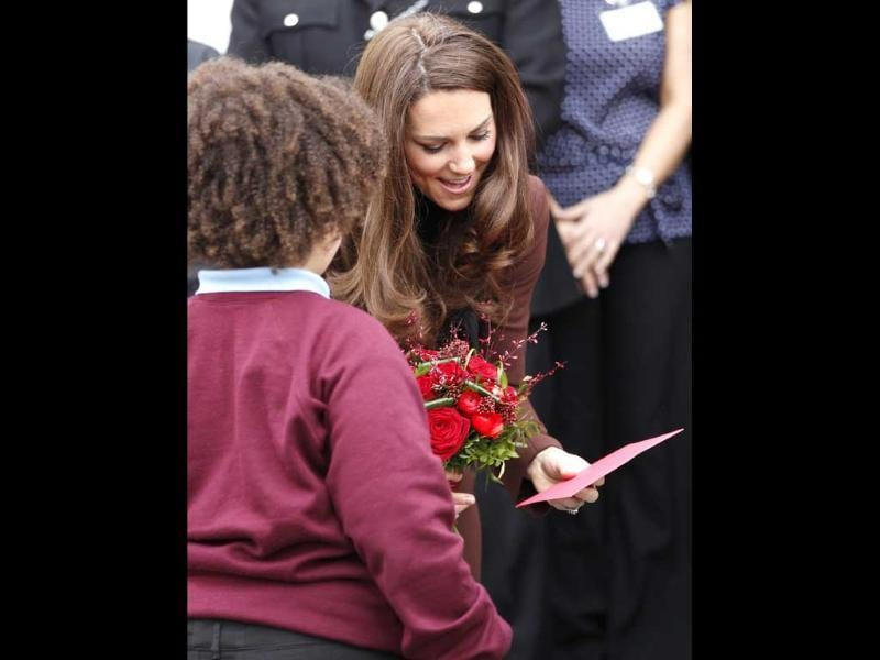 Britain's Catherine, Duchess of Cambridge, receives a Valentine's Day card from 8 year old Jaqson Johnston-Lynch during a visit to The Brink, an alcohol-free bar in Liverpool. Reuters/Darren Staples