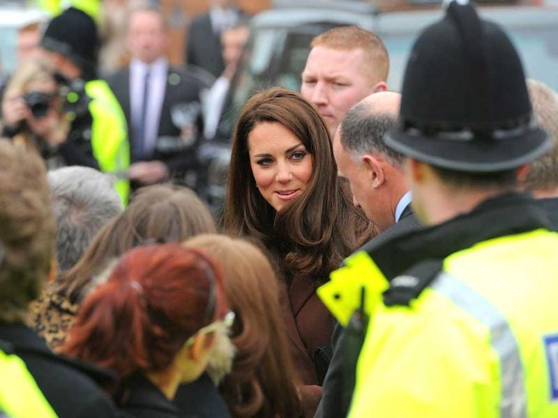 Catherine, The Duchess of Cambridge, (C) meets the public after an official visit to the Brink alcohol-free bar in Liverpool, north-west England. AFP/Andrew Yates