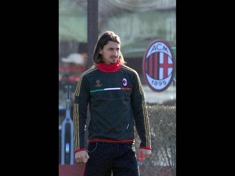 AC Milan's Swedish forward Zlatan Ibrahimovic looks on during a training session ahead of his team's Champions League football match against Arsenal in their training center of Milanello. AFP/Giuseppe Cacace