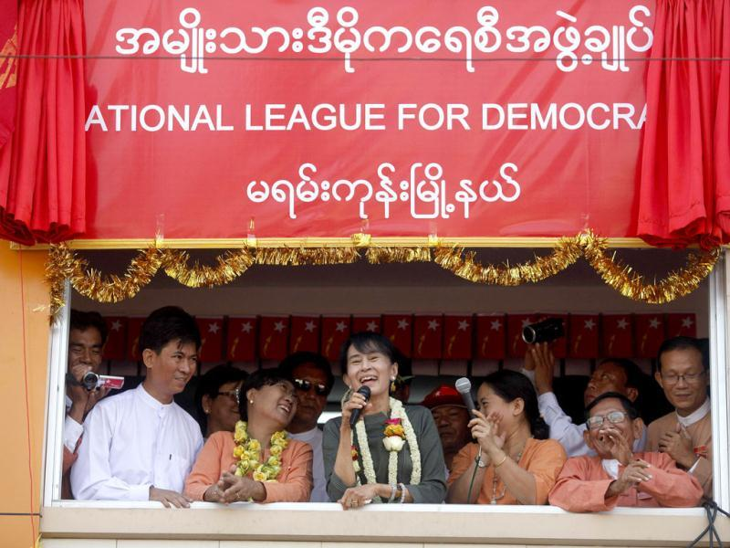 Pro-democracy leader Aung San Suu Kyi speaks to supporters during the opening ceremony of National League for Democracy party's Mayangon branch office in Yangon. Reuters/Soe Zeya Tun