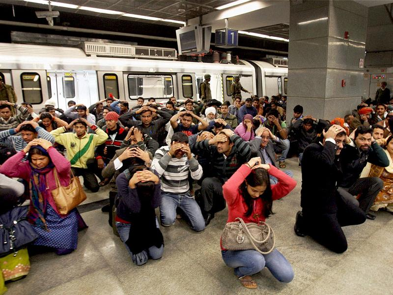 Metro passengers at the Khan Market Metro Station during a coordinated mock drill organised by Delhi Disaster Management Authority on earthquake-preparedness in New Delhi. PTI Photo/Subhav Shukla