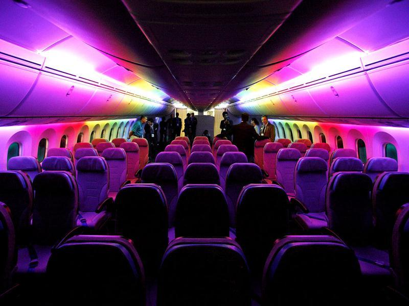The economy class cabin of a Boeing 787 Dreamliner is lit with rainbow colored LED lighting during a demonstration flight of the aircraft at the Singapore Airshow in Singapore. (Reuters)