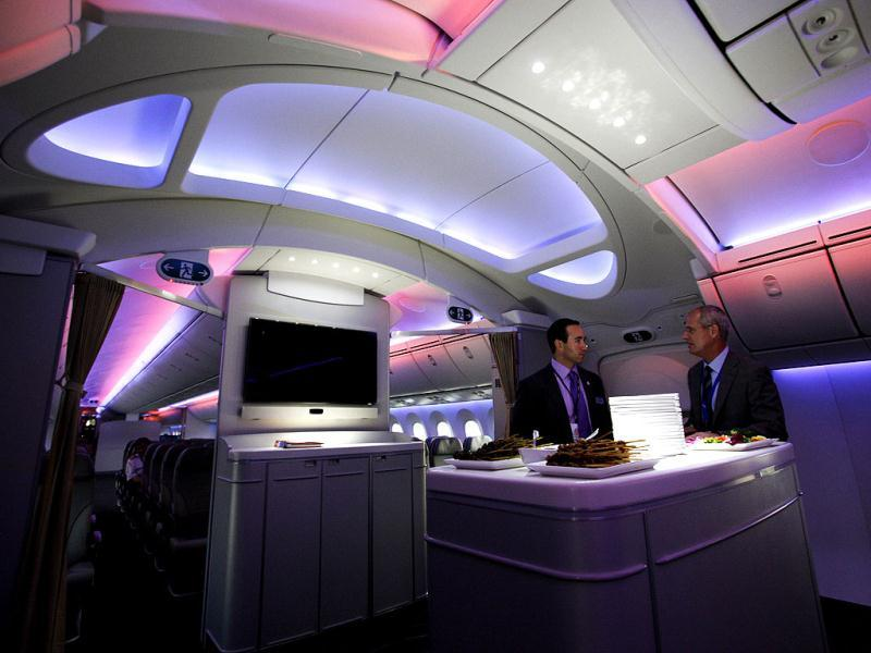 Mark Jenks (R), Boeing's vice president of 787-9 development, speaks to an executive along the archway of the 787 Dreamliner during a demonstration flight of the aircraft at the Singapore Airshow in Singapore. (Reuters)