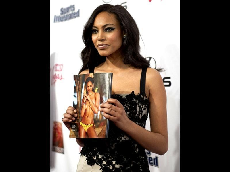 Ariel Meredith poses with her picture in the magazine. (AFP Photo)