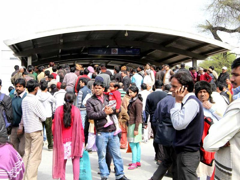 Delhi Metro passengers wait outside AIIMS metro station during a mock drill organised by Delhi Disaster Management Authority on earthquake-preparedness in New Delhi. HT Photo/ Arvind Yadav