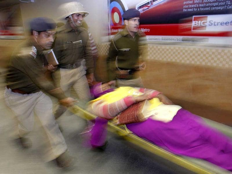 Policemen perform a mock rescue operation during a disaster drill to check the alertness and preparedness of various agencies in the event of a major earthquake, at a metro station, in New Delhi. AP Photo/Saurabh Das