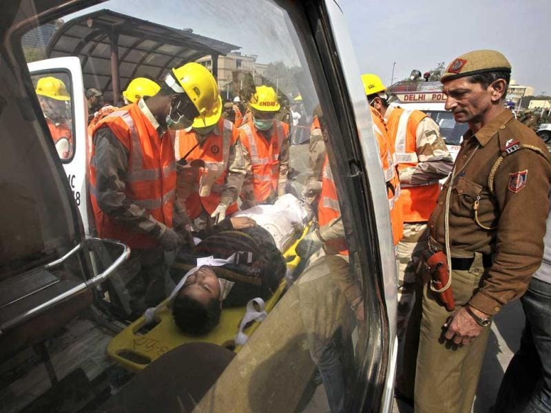 Disaster management officials perform a mock rescue during a disaster drill checking the alertness and preparedness of various agencies in the event of a major earthquake, in New Delhi. AP Photo/Manish Swarup