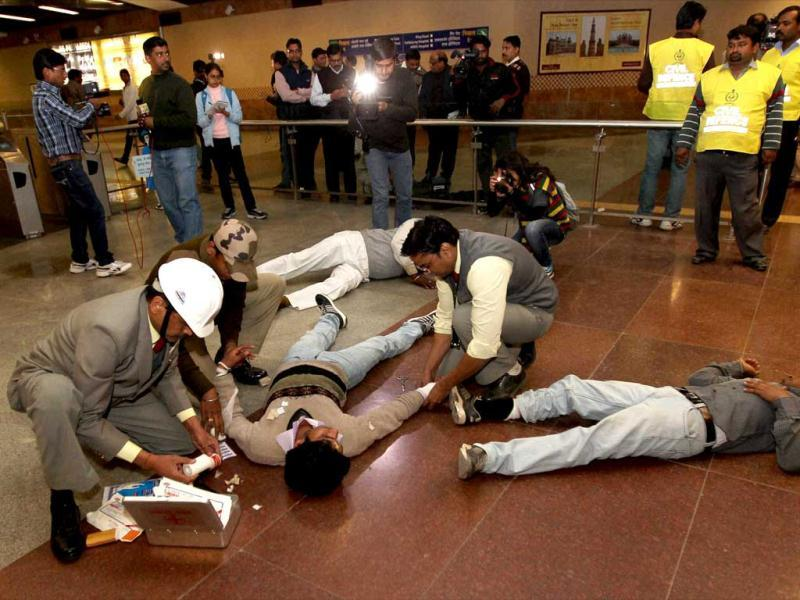 Civil Defence personnel attend injured people during a coordinated mock drill organised by Delhi Disaster Management Authority on earthquake-preparedness, at the AIIMS Metro Station in New Delhi. PTI Photo/Kamal Singh