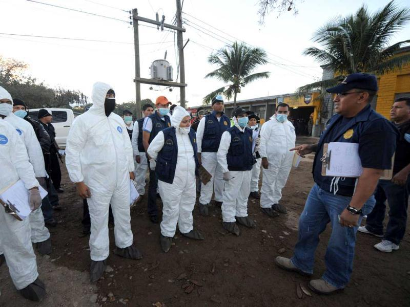 Forensic personnel prepare to enter the National Prison compound in Comayagua, Honduras. AFP