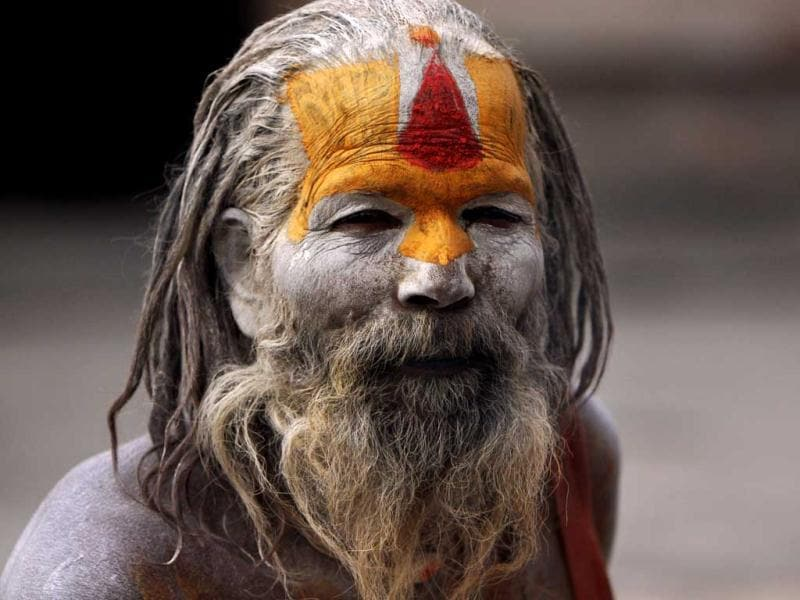 A sadhu, with his face and body smeared with ash, sits at the Pashupatinath Temple in Kathmandu. AP/Binod Joshi