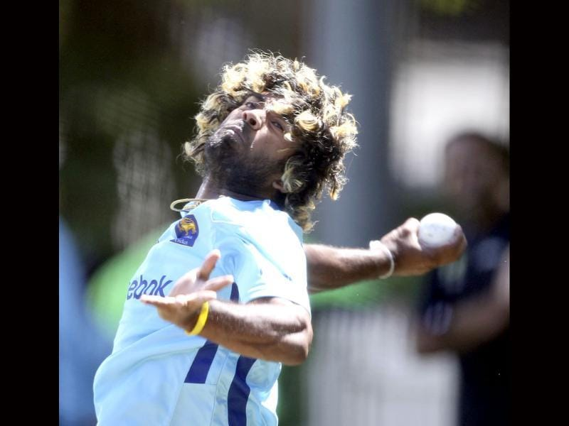 Sri Lanka cricketer Lasith Malinga bowls in the nets during a training in Sydney. AP Photo/Rob Griffith