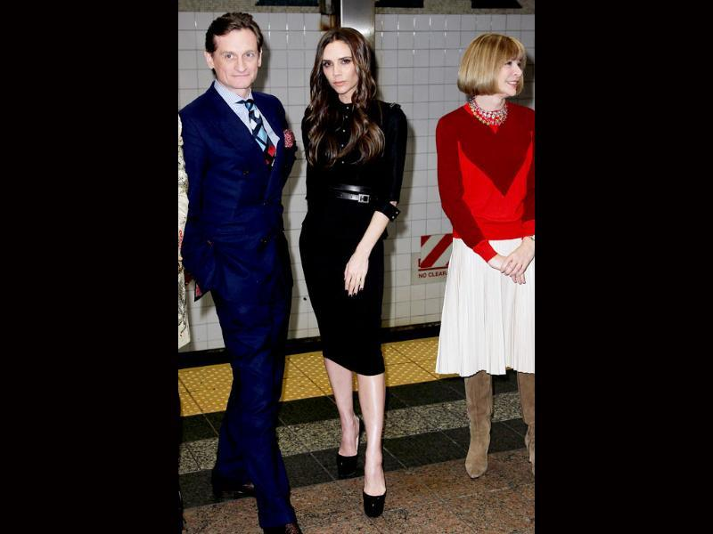 Vogue international editor-at-large Hamish Bowles (from left), Victoria Beckham and American Vogue editor Anna Wintour pose at Grand Central Station's 42nd Street subway shuttle during New York Fashion Week to launch Britain's GREAT Campaign. AP Photo/StarPix, Amanda Schwab