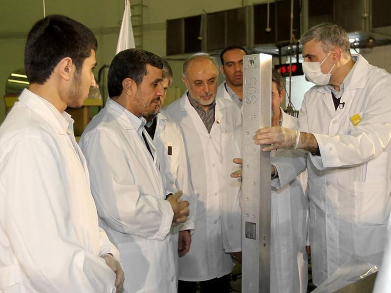 This photo released by the Iranian President's Office, claims to show Iranian President Mahmoud Ahmadinejad, second left being escorted by technicians during a tour of Tehran's research reactor centre in northern Tehran, Iran. (AP Photo/Iranian President's Office)