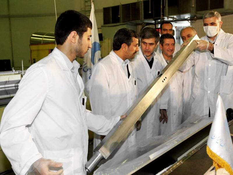 Handout picture released by the Iranian president's official website shows a metal-encased rod with 20% enriched nuclear fuel as it is inserted into Tehran's reactor. (AFP photo)