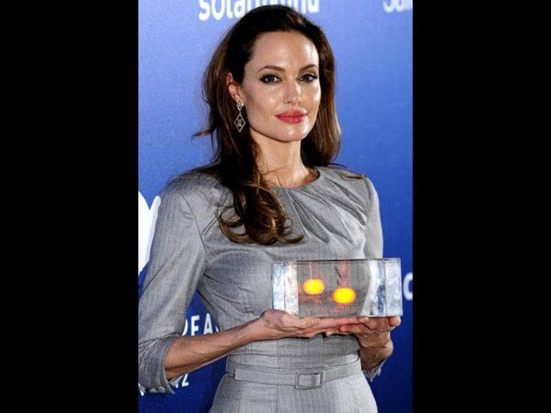 Angelina Jolie poses with the Honorary Award for opposing War and Genocide for her film In the Land of Blood and Honey during the Cinema for Peace gala on February 13, 2012 in Berlin.