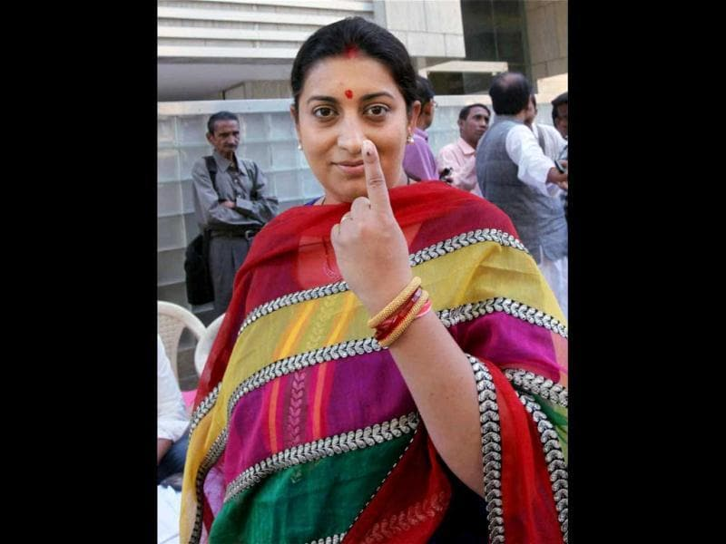 BJP leader and actress Smriti Irani shows her marked finger after casting vote for the corporation elections in Mumbai. PTI/Santosh Hirlekar
