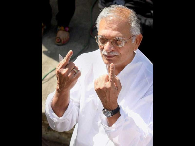 Renowned lyricist and writer Gulzar shows his unmarked fingers after failing to cast his vote for the corporation elections in Mumbai. He was unable to vote as his name was missing from the voters' list. PTI/Mitesh Bhuvad