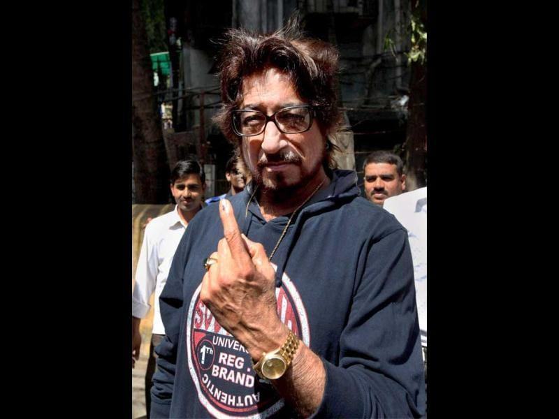 Actor Shakti Kapoor shows his marked finger after casting vote for the corporation elections in Mumbai. PTI/Santosh Hirlekar