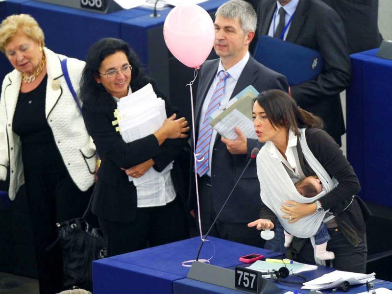Ronzulli takes part with her baby in a voting session on the working conditions of women at the European Parliament in Strasbourg on October 20, 2010. Reuters/Vincent Kessler