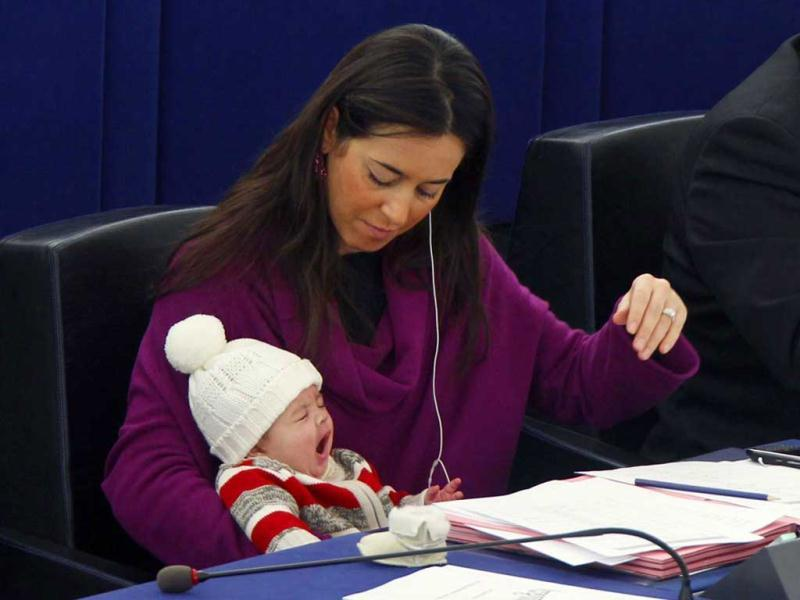 Ronzulli takes part with her baby in a voting session at the European Parliament in Strasbourg on December 16, 2010. Reuters/Vincent Kessler