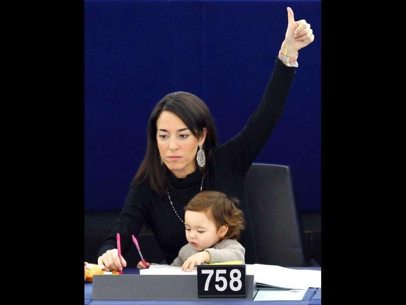 Ronzulli holds her baby during a voting session at the European Parliament in Strasbourg on December 14, 2011. Reuters/Vincent Kessler