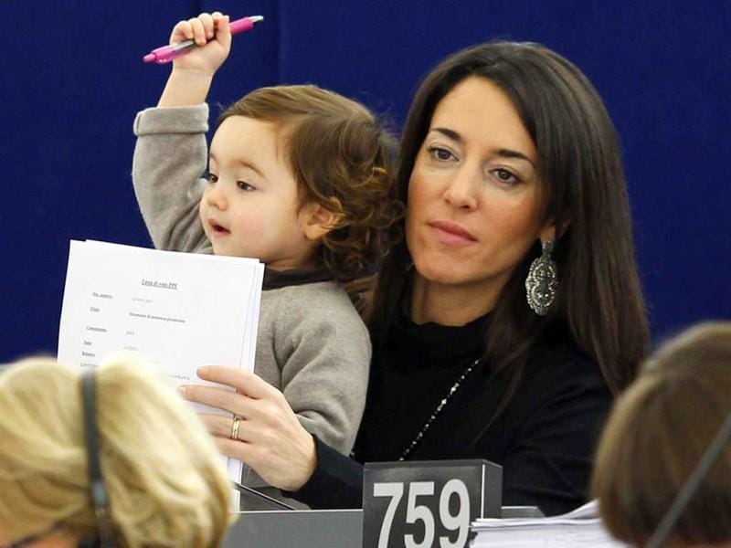 Ronzulli's daughter raises her hand during a voting session at the European Parliament in Strasbourg on December 14, 2011. Reuters/Vincent Kessler