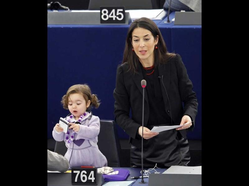 Ronzulli addresses the European Parliament as she stands besides her daughter after a voting session in Strasbourg February 15, 2012. Reuters/Vincent Kessler