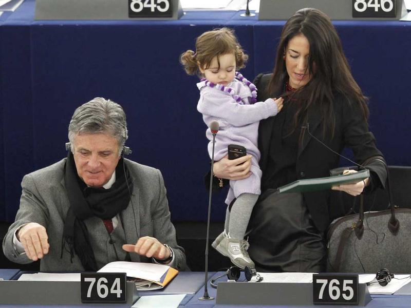 Italy's Member of the European Parliament Licia Ronzulli arrives with her daughter to take part in a voting session at the European Parliament in Strasbourg on February 15, 2012. Vittoria was first seen in the chamber at seven weeks old, tied in a sling around Ronzulli's shoulders. Reuters/Vincent Kessle