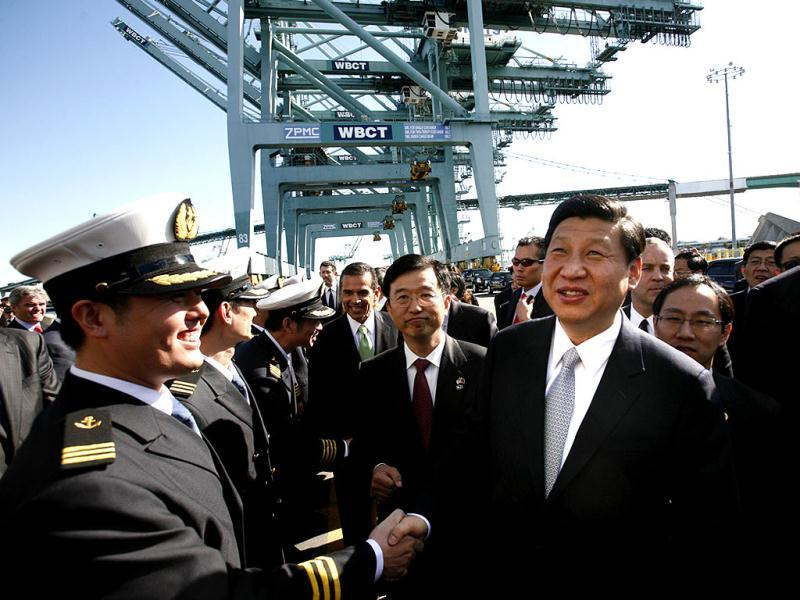 Chinese Vice-President Xi Jinping , right, shakes hands with officers as he tours China Shipping at the Port Of Los Angeles in San Pedro, California. AP/Los Angeles Times, Bob Chamberlin, Pool