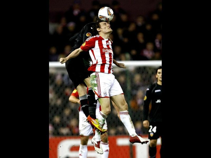 Stoke City's Dean Whitehead, center, vies for the ball against Valencia's Adil Rami during the first leg of their Europa League round of 32 soccer match at the Britannia Stadium, Stoke on Trent, England. AP/Tim Hales