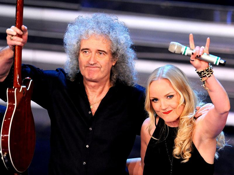 British singer Brian May performs and British singer Kerry Ellis wave at the Ariston Theatre in San Remo, during the 62nd Sanremo Music Festival. AFP/Tiziana Fabi
