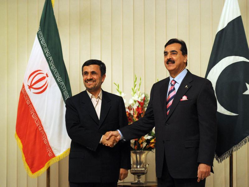 Pakistan's Prime Minister Yousuf Raza Gilani (R) shakes hands with Iranian President Mahmoud Ahmadinejad upon his arrival at the Prime Minister House in Islamabad. AFP/Aamir Qureshi