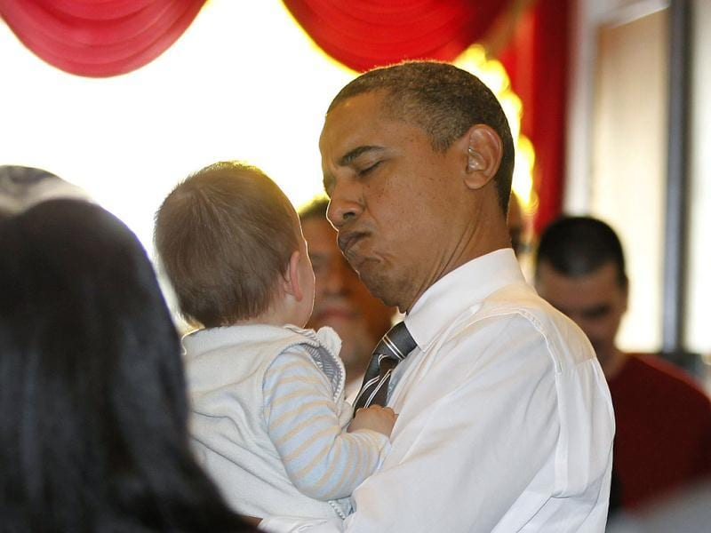 US President Barack Obama reacts while holding a baby as he greets diners at the Great Eastern Chinese restaurant in San Francisco. Reuters/Jason Reed