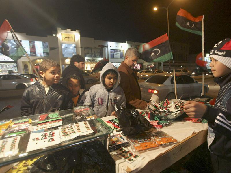 Boys check out a stall with Kingdom of Libya flags on the streets of Benghazito as Libya marks the first anniversary of revolutionary uprising against Muammar Gaddafi. Reuters/Esam Al-Fetori