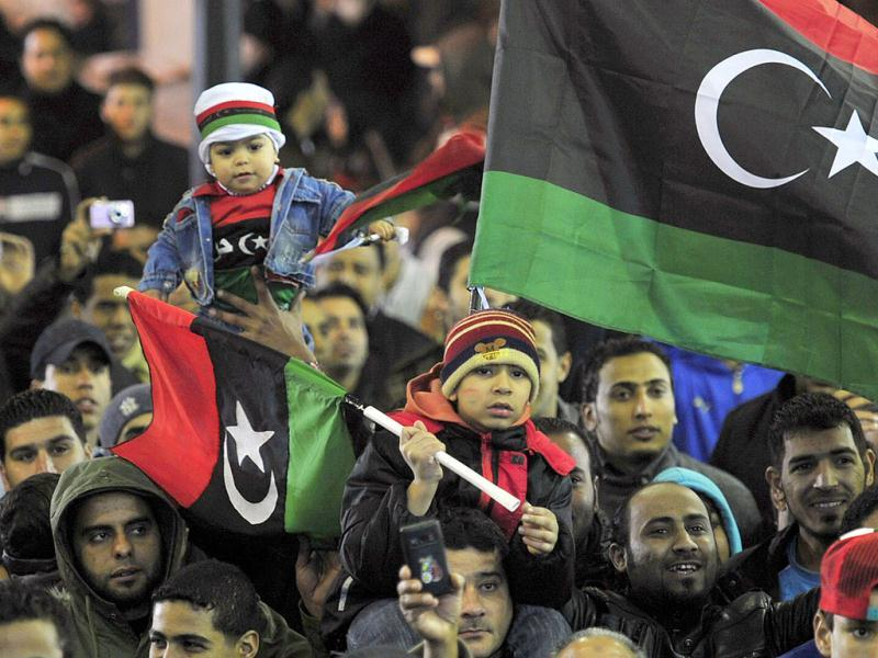 People with the Kingdom of Libya flags gather during a celebration to mark the first anniversary of revolutionary uprising against Muammar Gaddafi. Reuters/Esam Al-Fetori