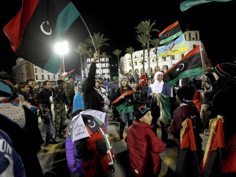 Families celebrate the one-year anniversary since the revolutionary uprising against Muammar Gaddafi, at Martyrs Square in Tripoli. Reuters/Ismail Zitouny