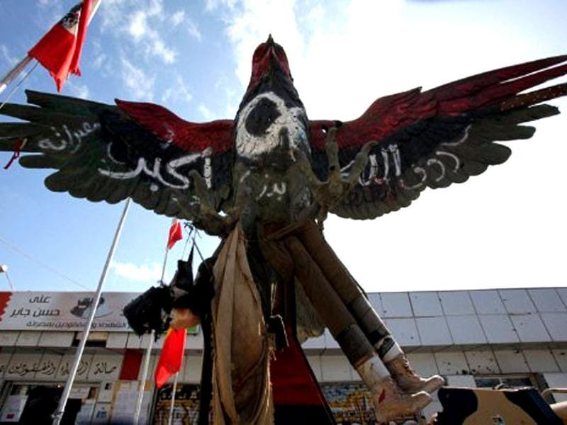 A falcon statue, painted in the colours of the revolutionary flag and covered with the inscription