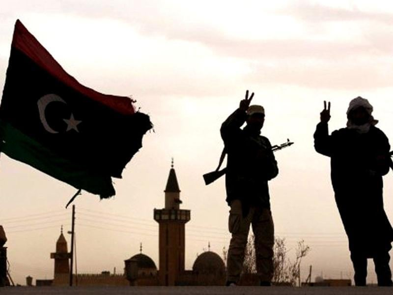 Libyan National Transitional Council (NTC) fighters flash the victory sign as they man a checkpoint south of Bani Walid. AFP/Karim Sahib, File
