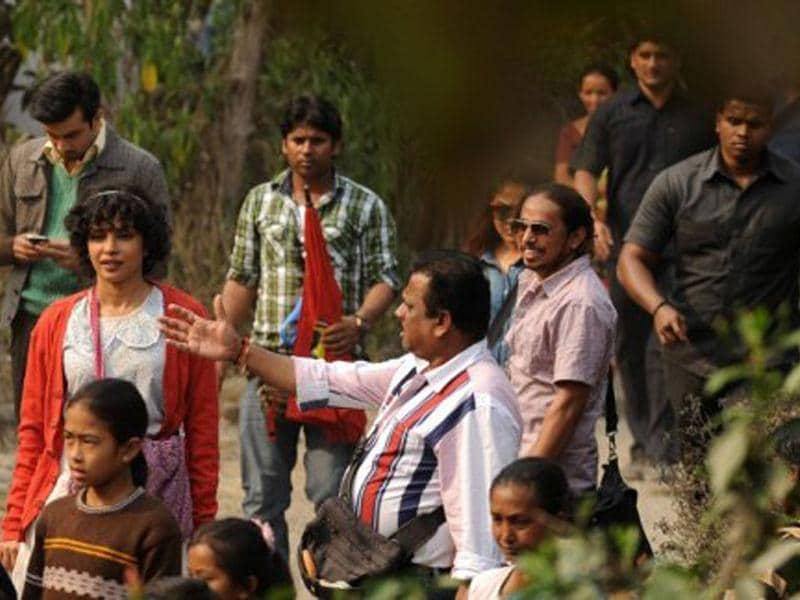 Priyanka Chopra is surrounded by fans during filming for the movie Barfee directed by Anurag Basu.