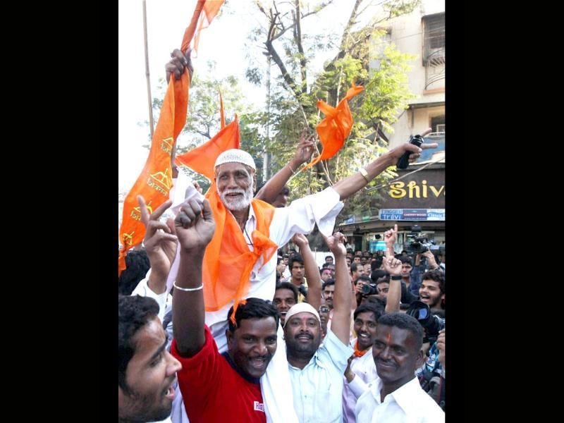 Shiv Sena workers celebrate the party's win in the corporation elections in Mumbai. PTI/Santosh Hirlekar