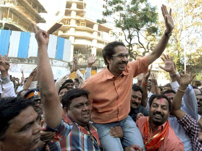 Shiv Sena executive president Uddhav Thackeray with party workers celebrate their win in the corporation elections near Sena Bhavan in Mumbai. PTI/Santosh Hirlekar