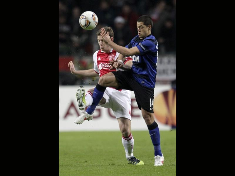 Jan Vertonghen of Ajax, left, and Javier Hernandez of Manchester United vie for the ball during the round of 32 Europa League soccer match at ArenA stadium in Amsterdam, Netherlands. AP/Peter Dejong