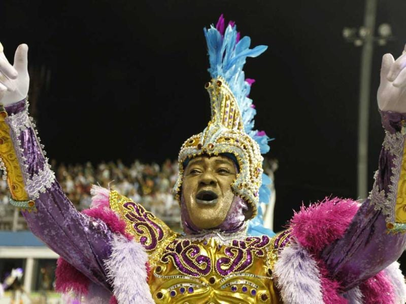 A reveller of Camisa Verde e Branco samba school sings and dances during the opening night of parades at the Sambadrome, as part of Carnival celebrations in Sao Paulo. AFP/Brazil Photo press/Vanessa Carvalho