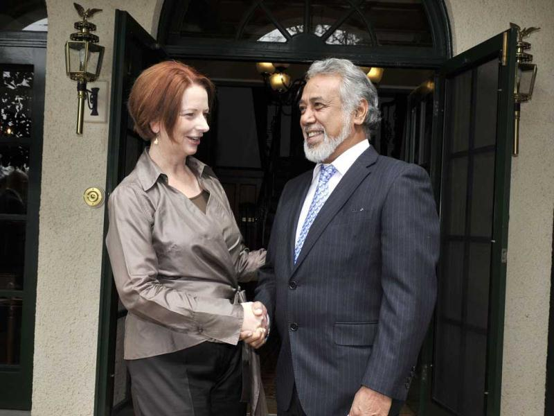 Australian Prime Minister Julia Gillard (L) greets East Timor Prime Minister Xanana Gusmao at the Lodge in Canberra. AFP/POOL