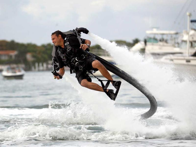 Sean Phillips flies through the air as he demonstrates the JetLev water propelled jet pack that is strapped to his back at the Yacht & Brokerage Show in Miami Beach, Florida. Joe Raedle/Getty Images/AFP