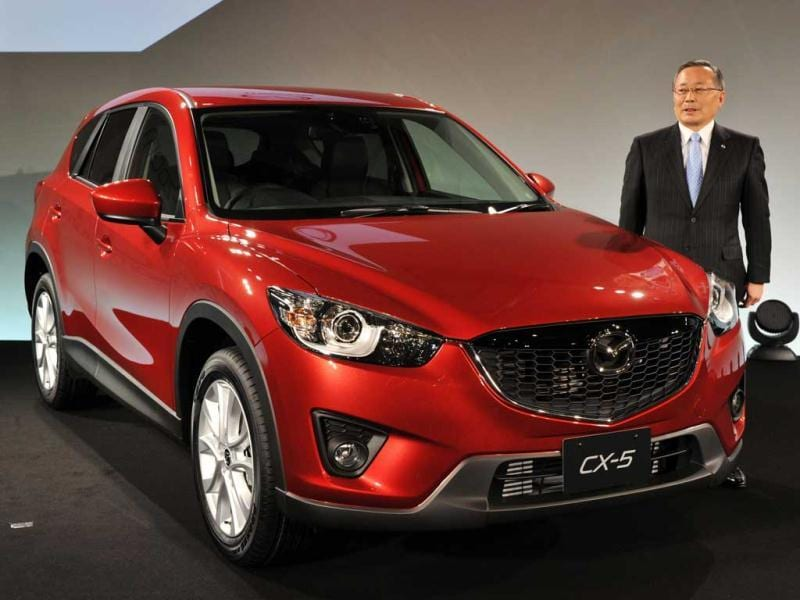 Japan's automaker Mazda President Takashi Yamanouchi introduces the new crossover vehicle CX-5, which has 2.0-litter or new developed 2.2-litter diesel engine in Tokyo. The new diesel engine, called Skyactiv-D, features high performance, clean and good economy efficiency which achieves 18.6km per liter. AFP/Yoshikazu Tsuno