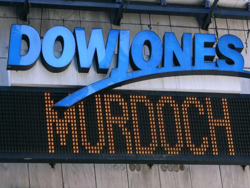 The Dow Jones news ticker in New York's Times Square displays the headline that Rupert Murdoch's News Corp. has made a deal to buy Dow Jones & Company for some $5 billion. Reuters/Mike Segar