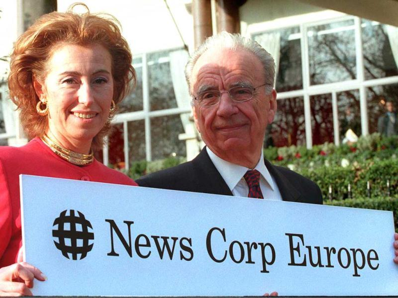 Rupert Murdoch, Chairman of News Corporation Limited stands beside the newly appointed Chairman of News Corp Europe, Mrs Letizia Moratti, outside a London Hotel where he announced the formation of News Corp Europe. PM/GB