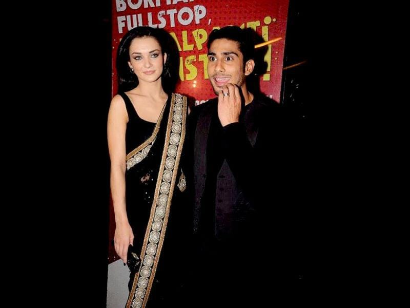 Prateik Babbar gives a funny expression, while Amy Jackson looks on.