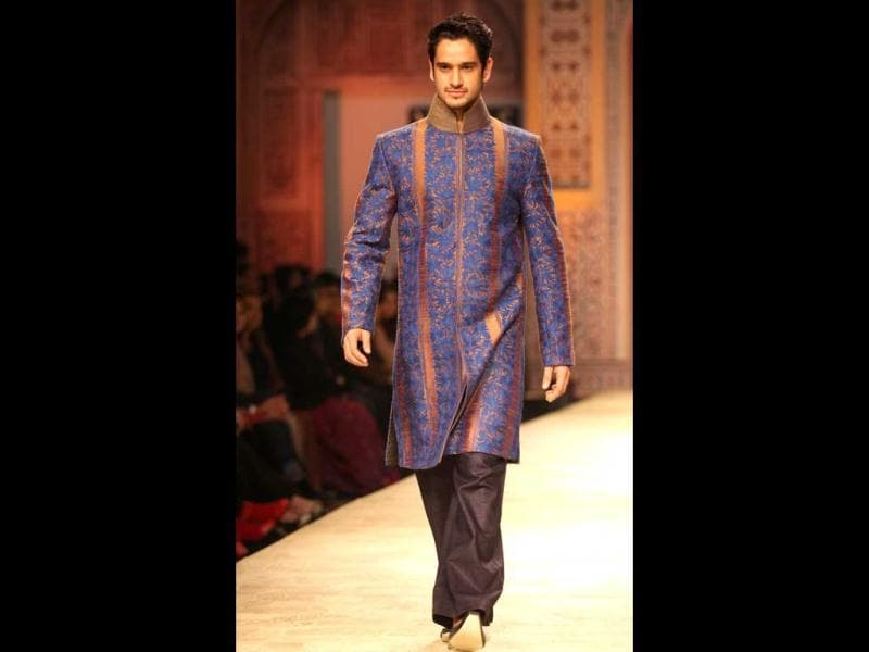 A model walks the ramp for Manish Malhotra in an embroidered-bandhgala.